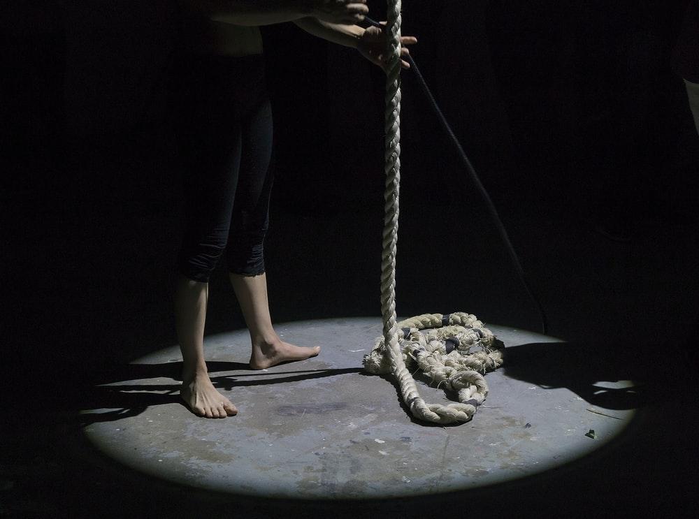 man holding brown rope