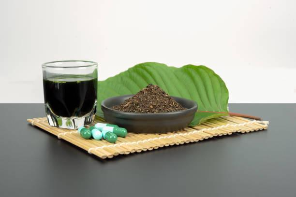 Mitragynina speciosa or Kratom Mitragynina speciosa or Kratom leaves with powder product in white ceramic bowl and water from the extracts the kratom leaves. Supplement kratom green capsules. kratom stock pictures, royalty-free photos & images